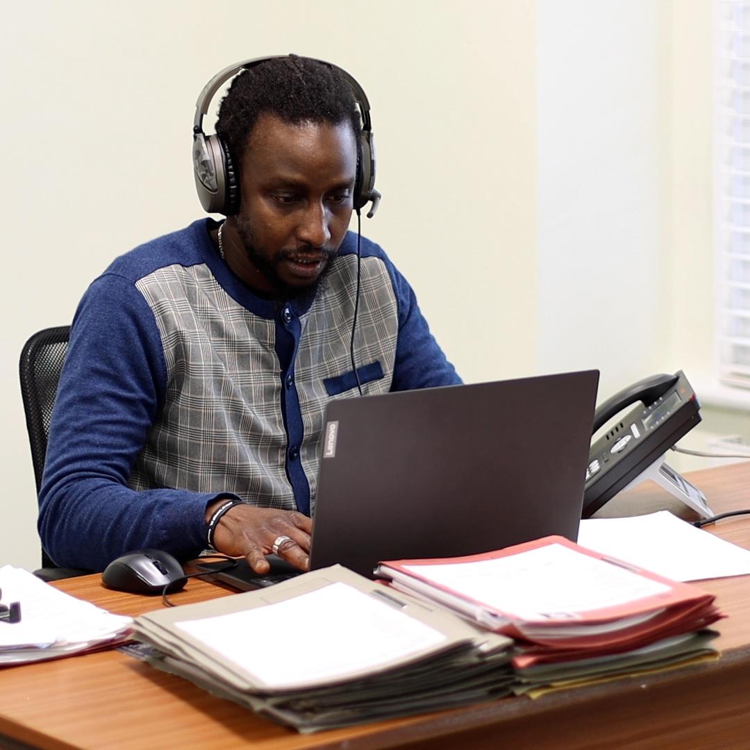 Caseworker using computer