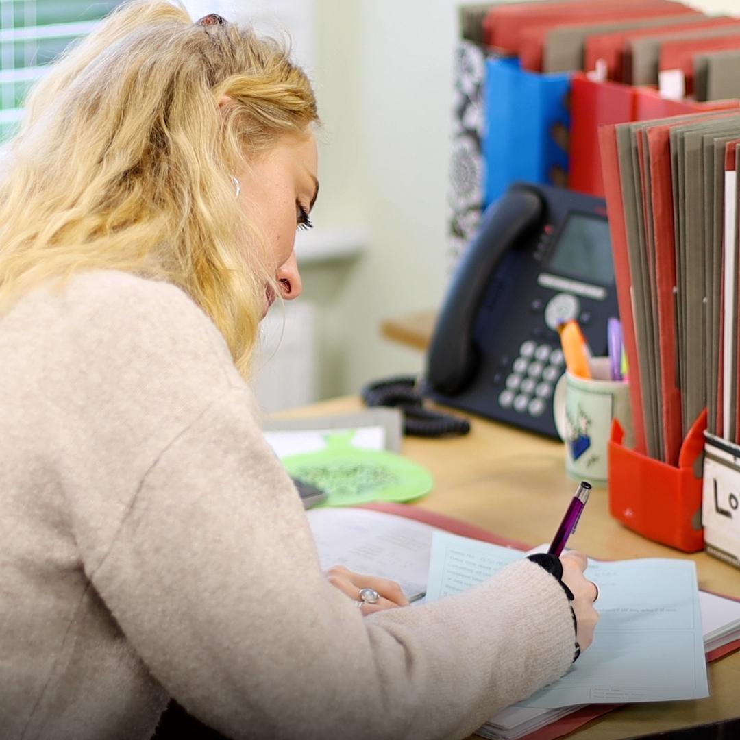 Caseworker completing paperwork