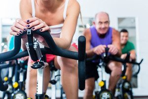 Graphicstock Group Senior And Young People In Spinning Course On Fitness Bike In Gym Doing Endurance And Cardio Training The Instructor Is Leading Them On BPXgGMsDpg Thumb