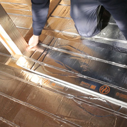 The upstairs heating was originally specified as radiators, however, the developer decided that he'd like underfloor heating throughout the properties.