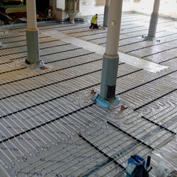 Underfloor heating looked like the best option because it is mainly radiant rather than convective heat.