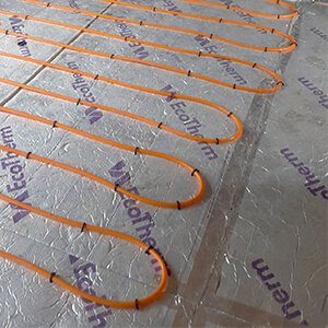 Heat pump and controls with underfloor heating