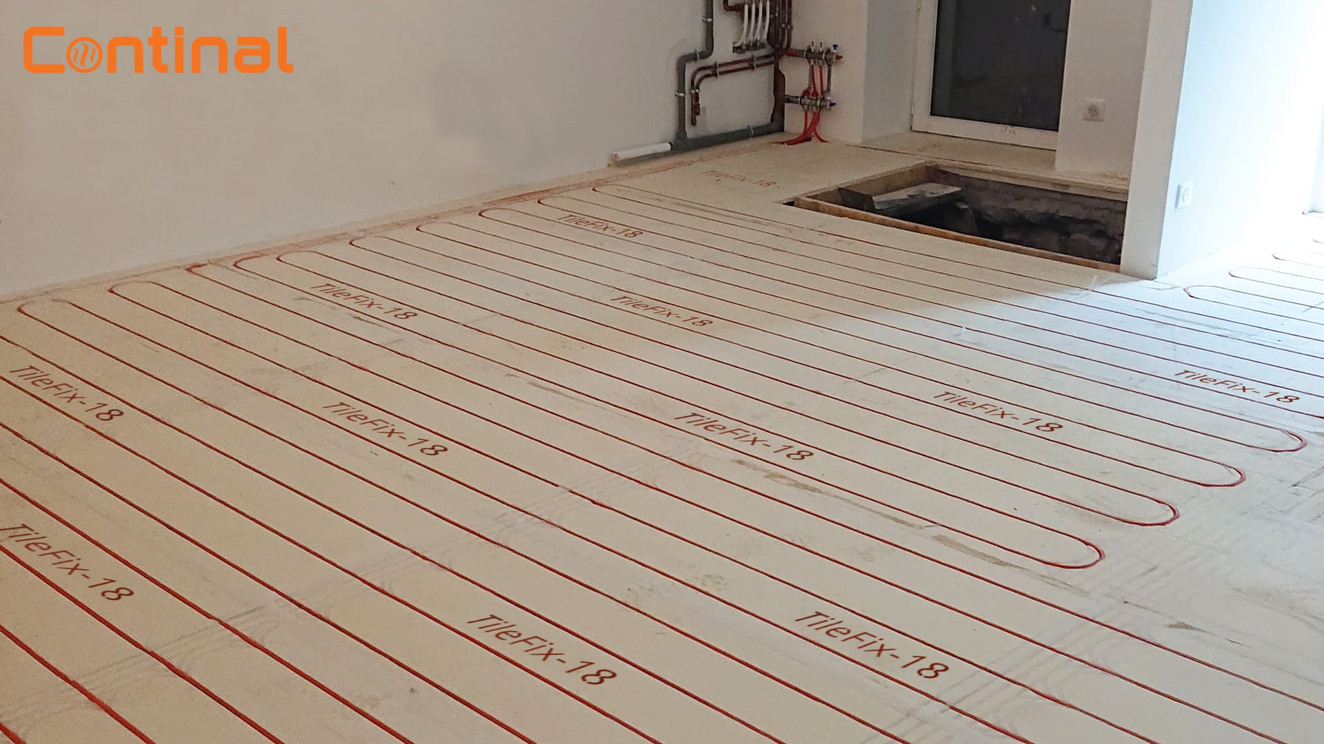 The Continal team was contacted by a homeowner who wanted to add energy-efficient, warm-water underfloor heating to the dining room and kitchen of his four-bedroom detached home in Surrey.