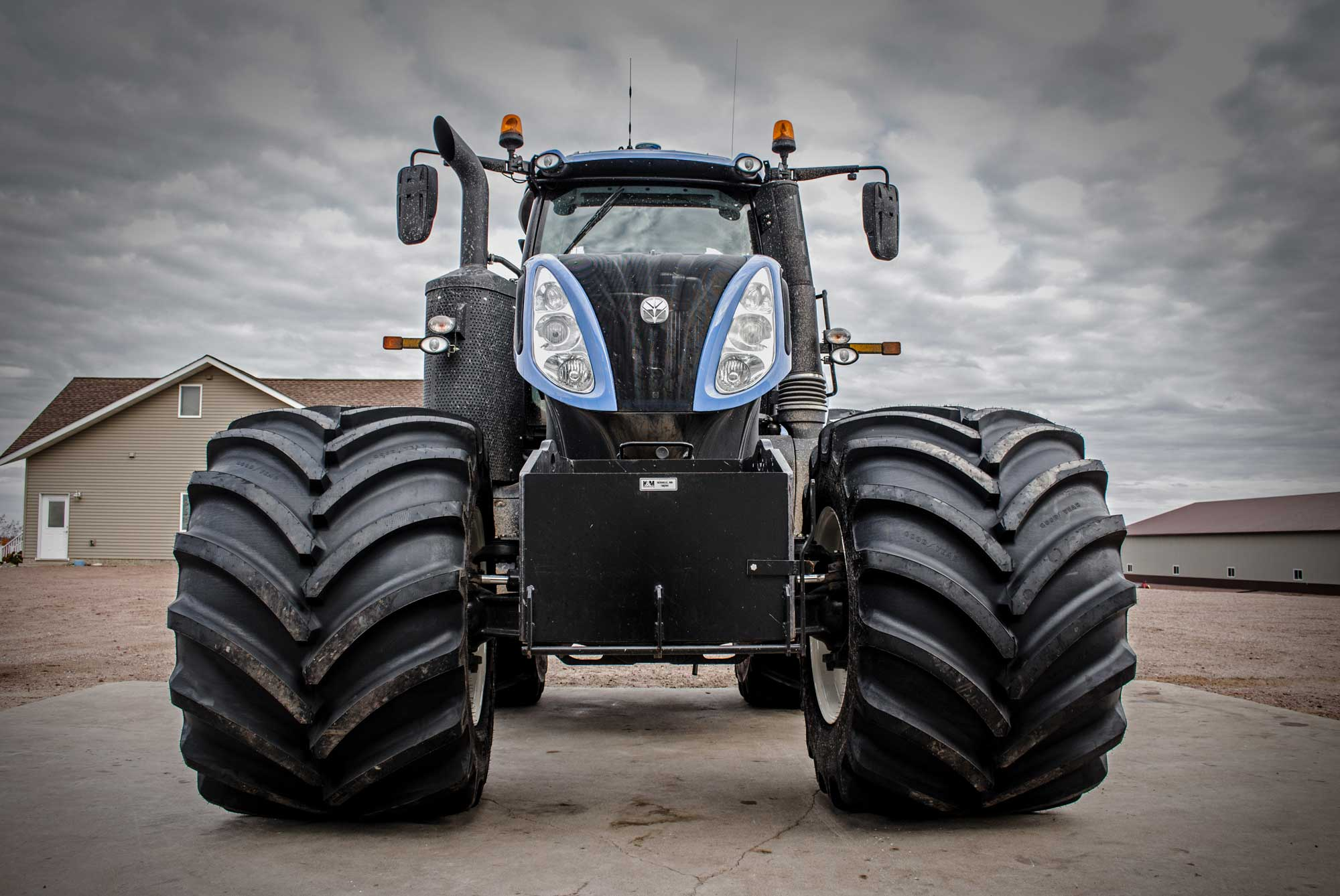 New Holland tractor with Goodyear LSW 1100 Super Singles for planting and grain carting