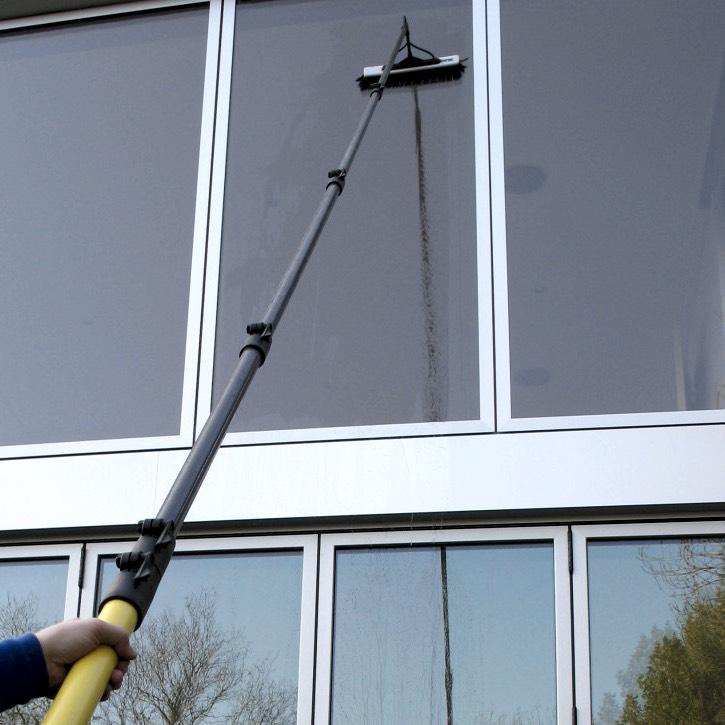 Commercial building in Peoria getting window cleaned