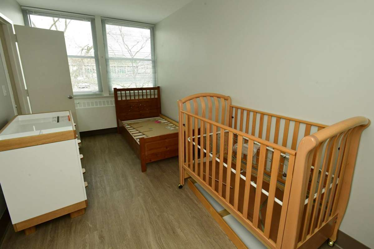 A bedroom for baby and mom
