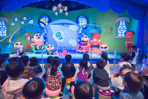 Children fascinated by Panda's Family Fantasy at Chimelong Panda Resort