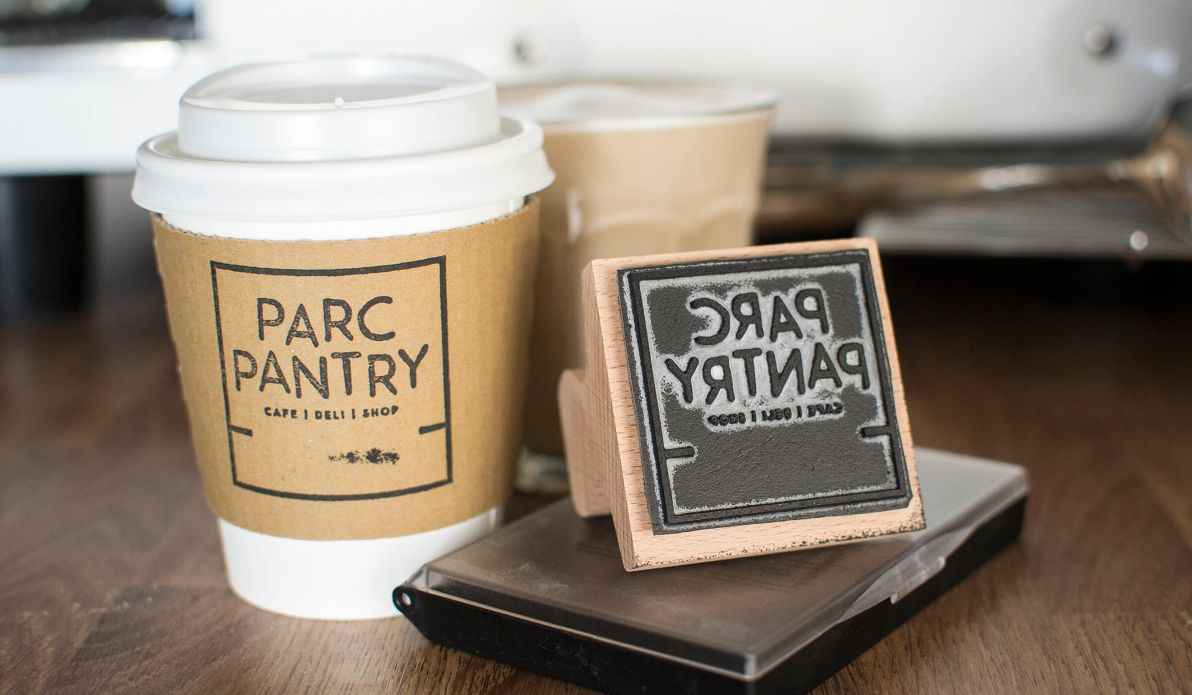 stamped logo design and coffee cup branding