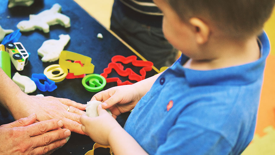 Toddler creating with Playdoh at Little Paws