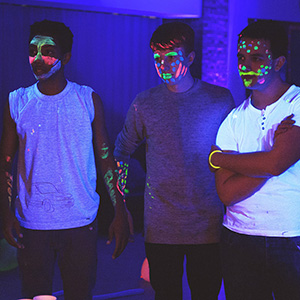 Young people in neon facepaint at Indigo