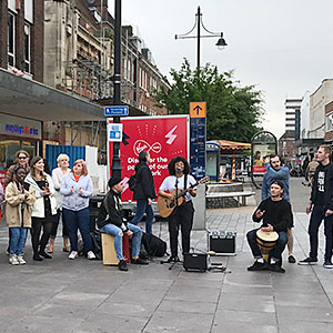 Crowd of people worshipping in the streets of Romford