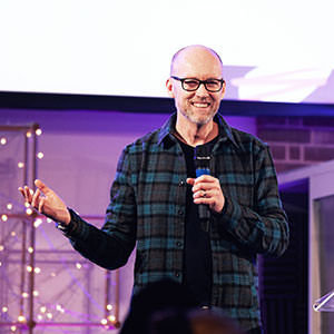 James Poch smiling while he is preaching at regeneration Church during a Half Four service