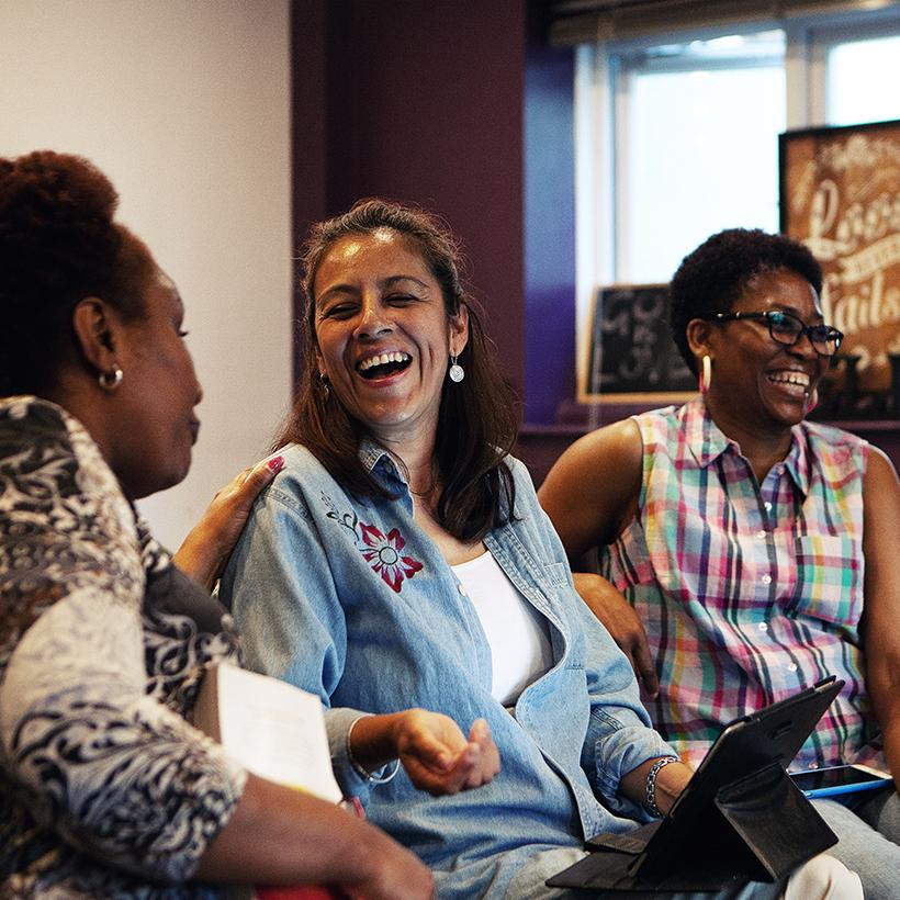 A group of women at Magenta laughing with each other