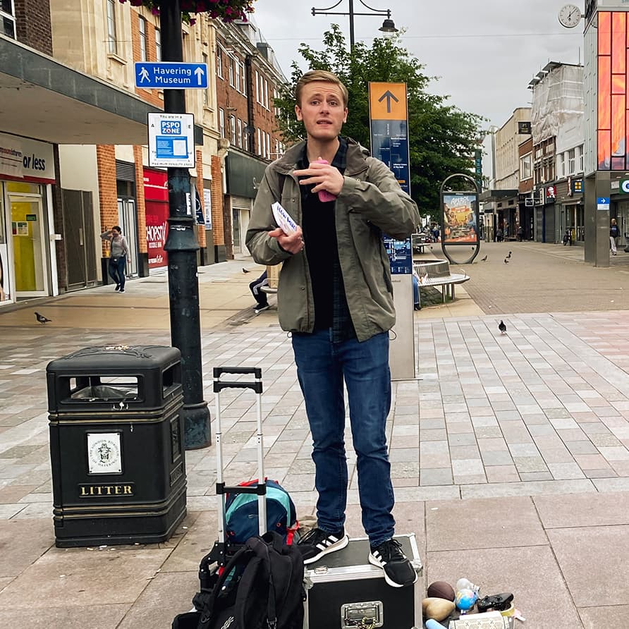 Christian evangelising with a prop on Romford High Street