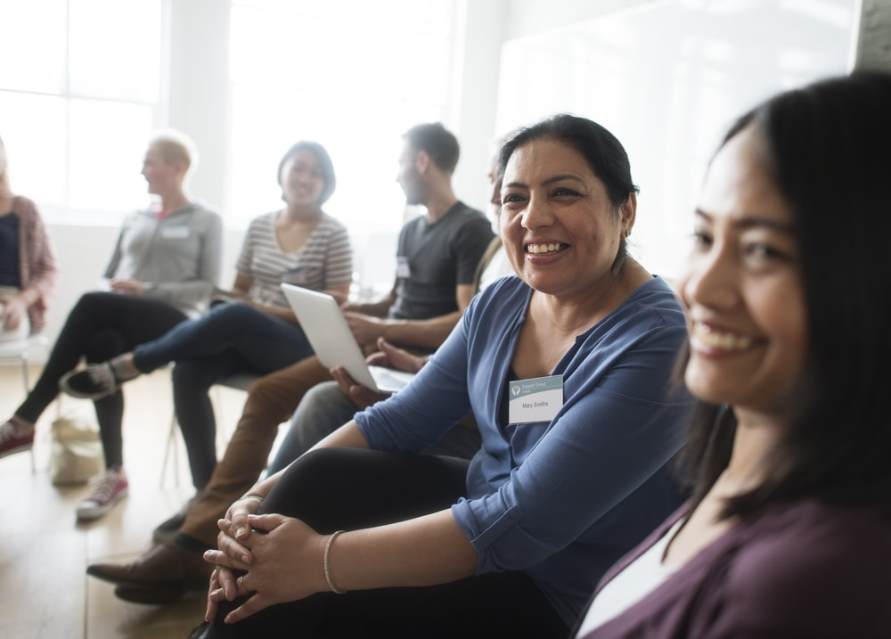 Support group with women smiling