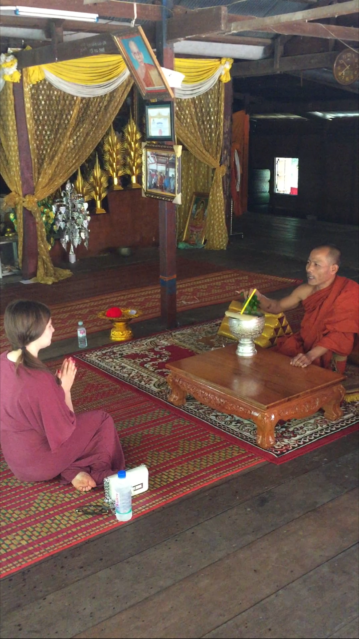 Receiving a Water Blessing from a Monk