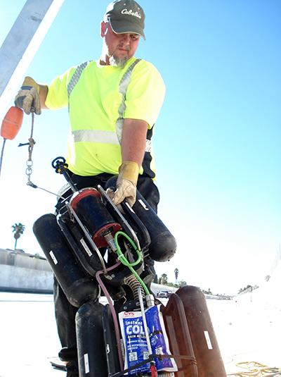 Pipeline inspection technician deploying robotic equipment