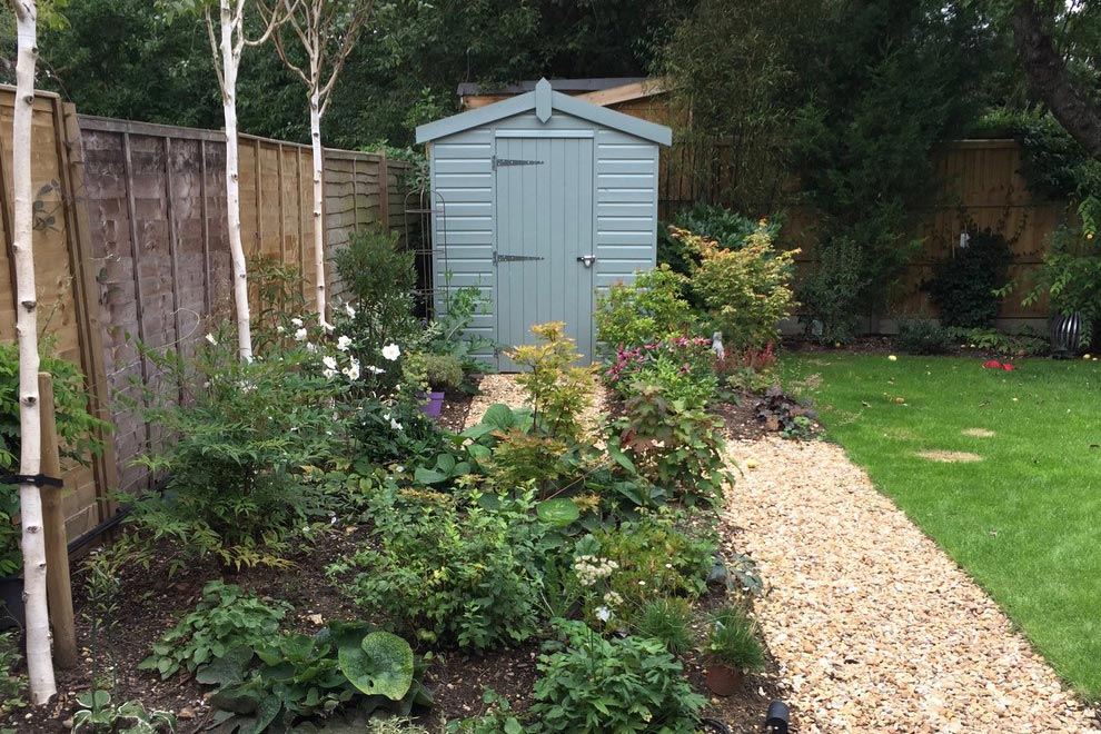Small town garden with large pond, Blackmore End, Wheathampstead