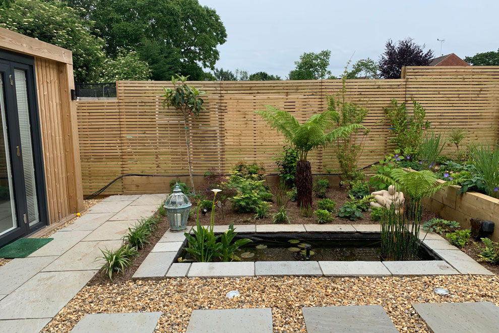 Family garden with slope in Wheathampstead, St Albans