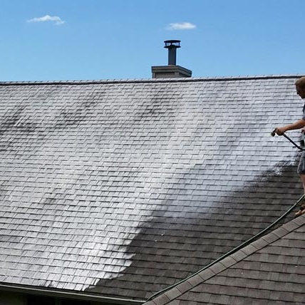 Cleaning a roof in Vancouver with Soft Washing process
