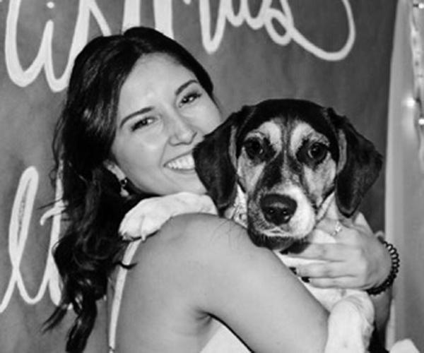 Brooke Starnes Hugging a Puppy