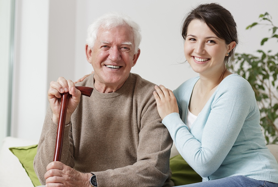 Elderly man and care taker