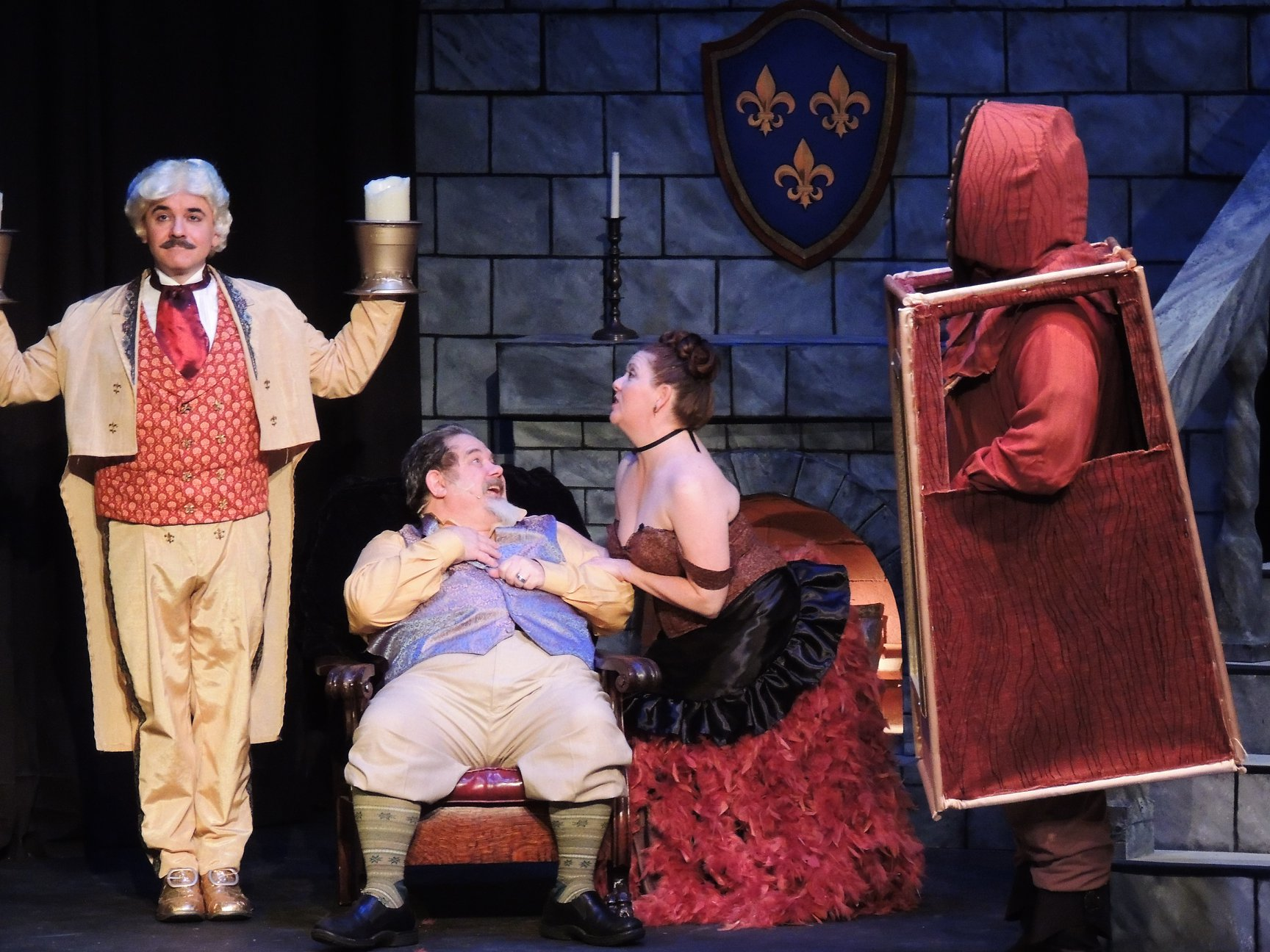 Lumiere, Babette and Cogsworth make Maurice feel at home in the castle.