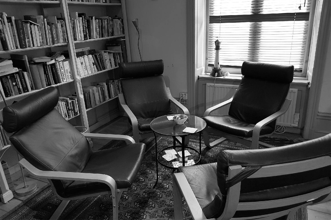 Four chairs in a room.