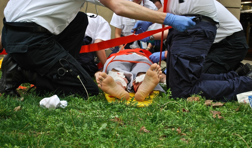 EMTs on scene caring for an overdose victim