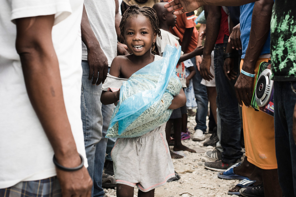 Charity for NPH Italia Onlus - Distribution of Pasta in Haiti
