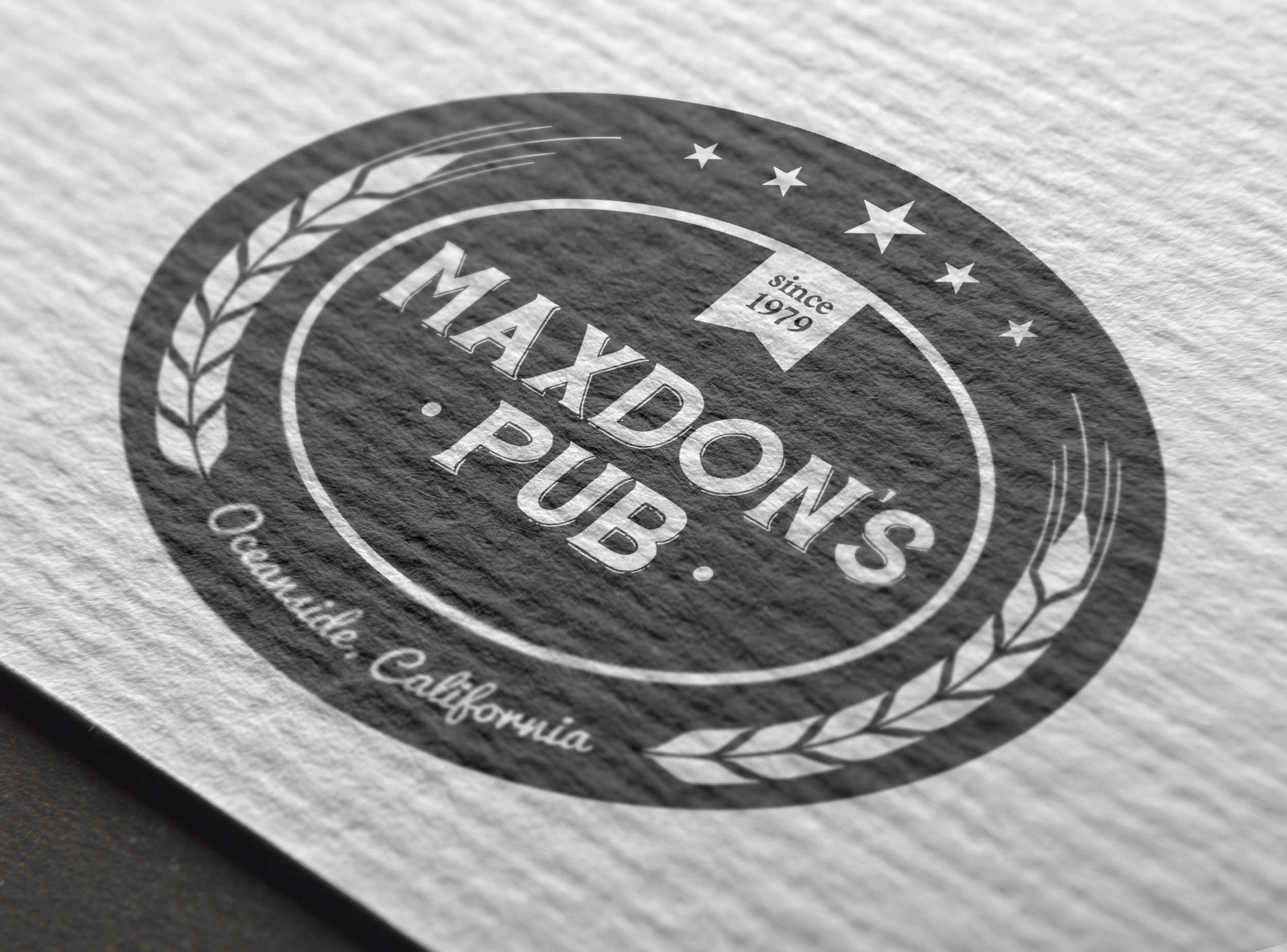 Maxdon's Pub logo on a business card.