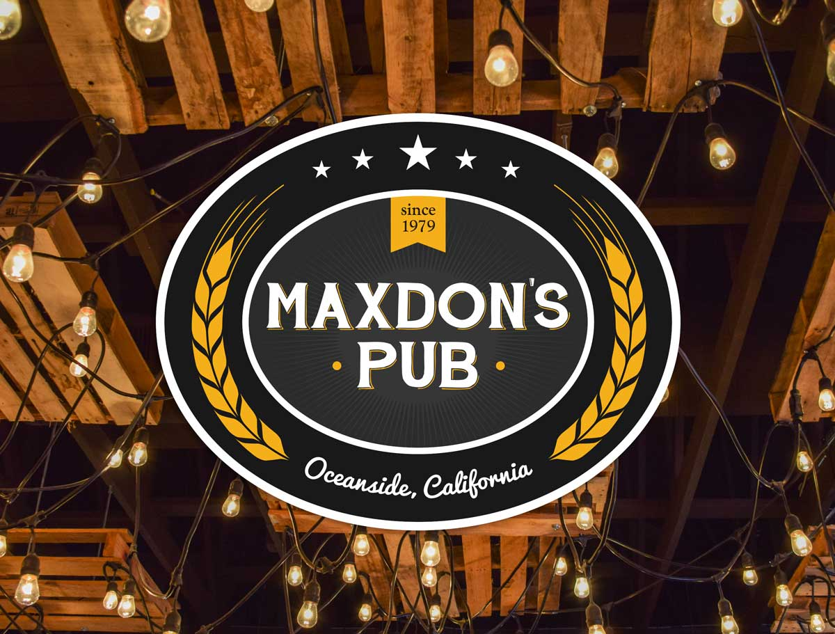 Maxdon's Pub logo over a photo of their bar's ceiling and lights.