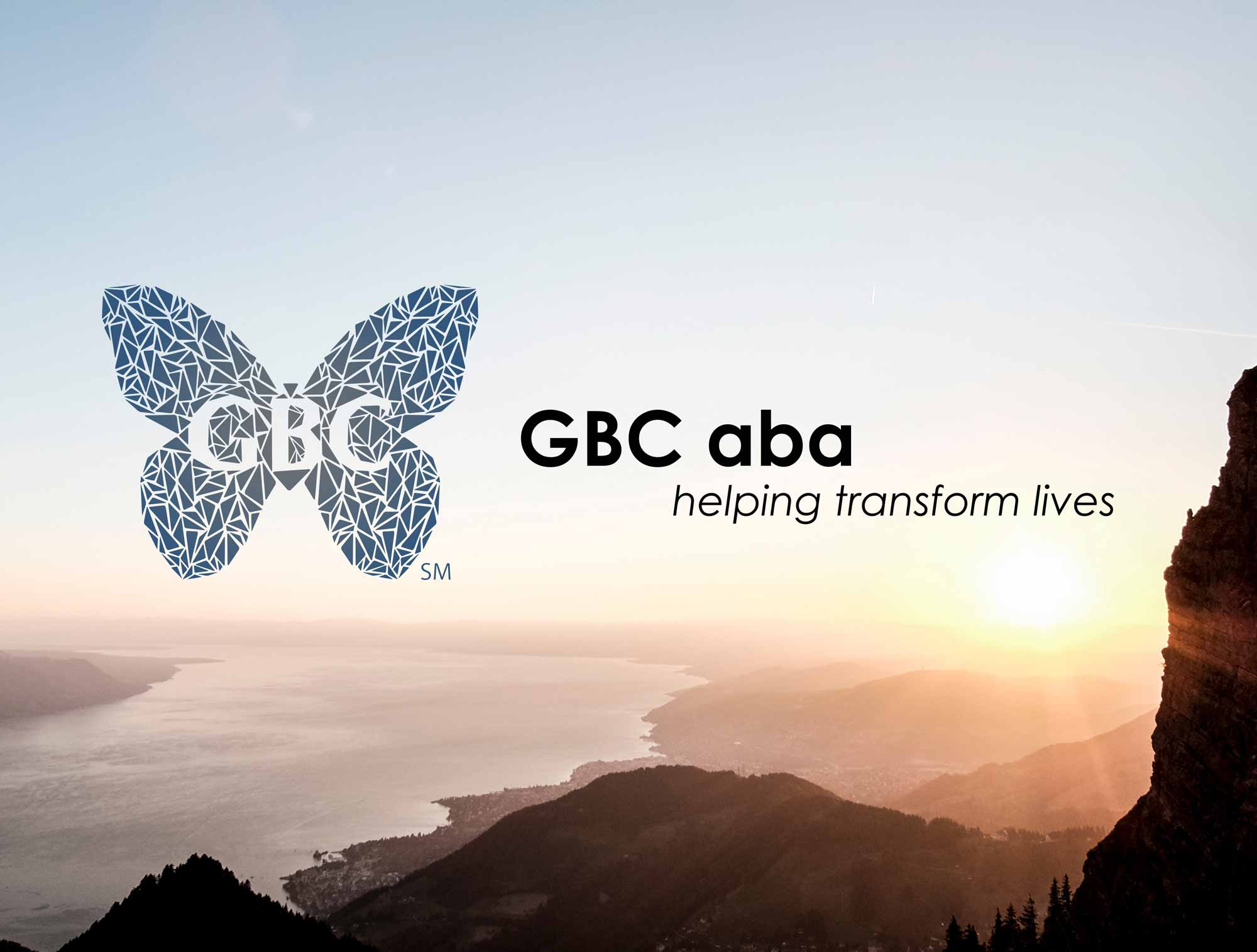 GBCaba logo over a photo of a horizon at sunset.