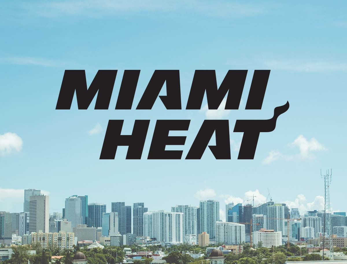 Miami Heat logo over the Miami skyline.
