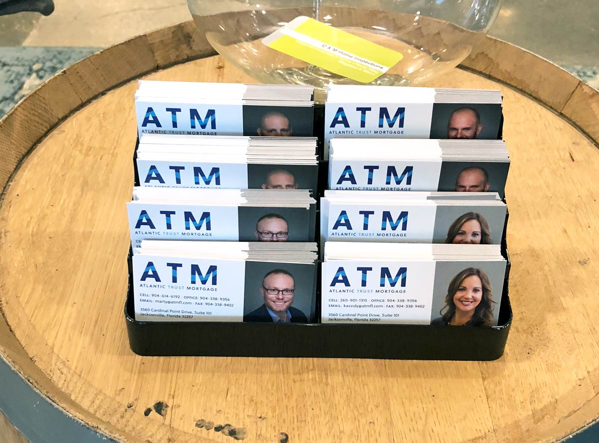 Atlantic Trust Mortgage business card display at the launch party in Jacksonville, FL.