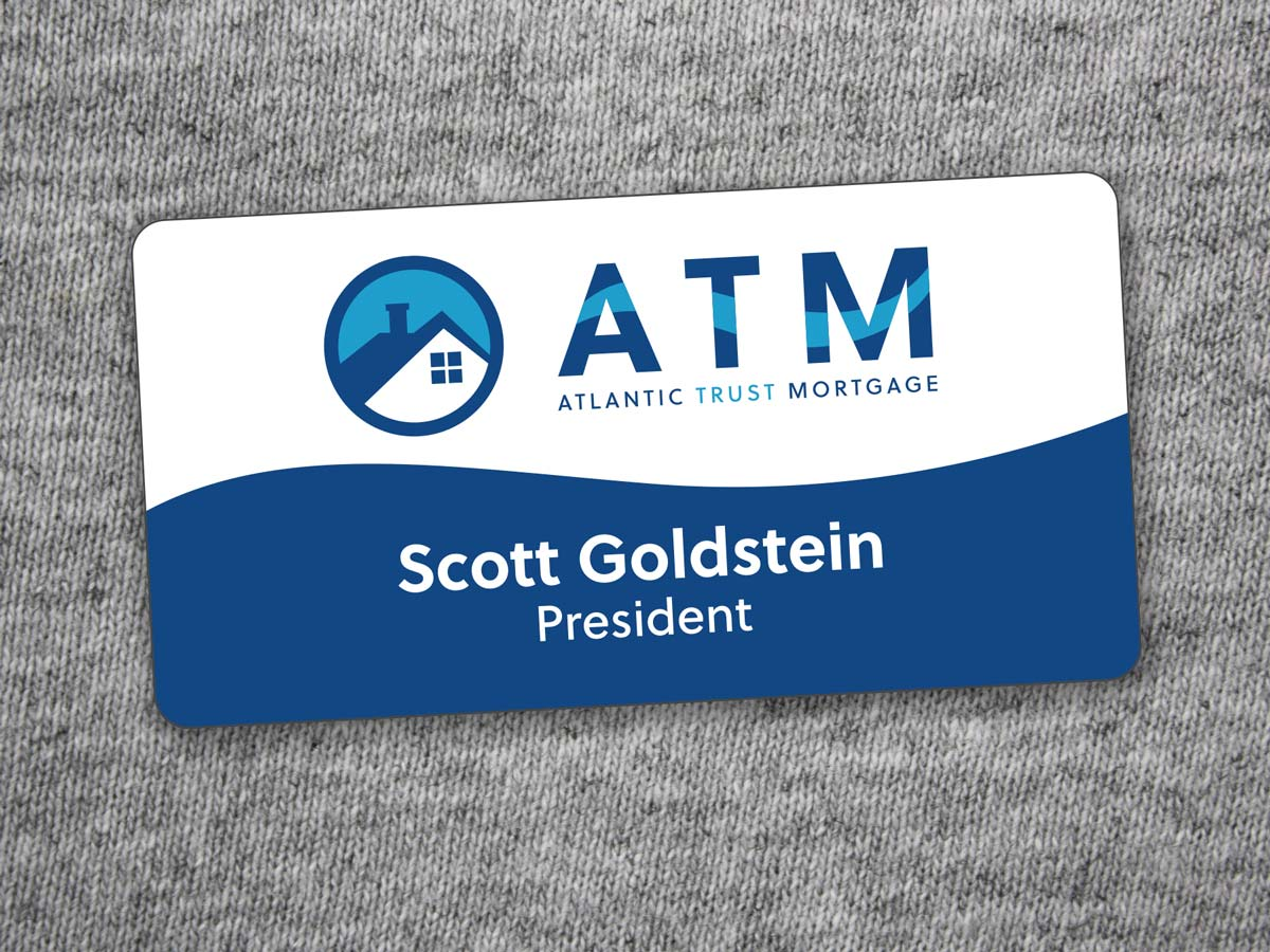 Atlantic Trust Mortgage nametag on a gray t-shirt background.