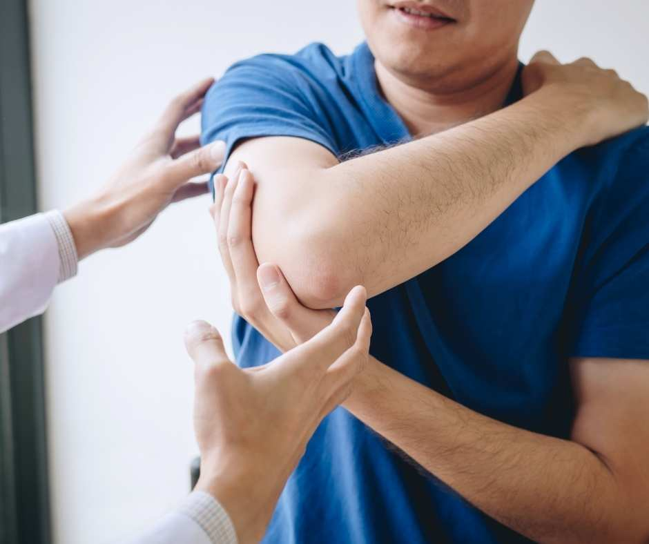 Physiotherapist assessing patient's arm pain