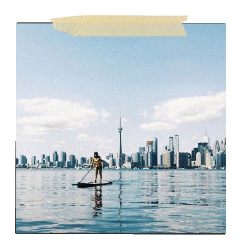 Photo of Olivia paddle boarding in Toronto.