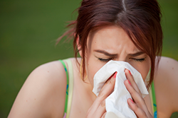 Woman suffering from chronic sinusitis symptoms.