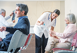 Caring, attentive nurse helping a patient understand appointment information