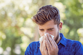 Man Suffering from Symptoms of Allergic Rhinitis