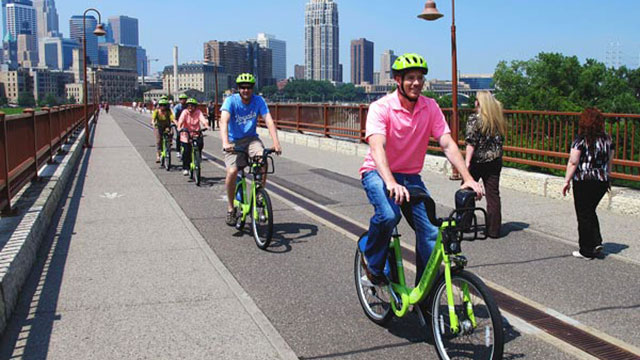 Biking across the Stone Arch Bridge