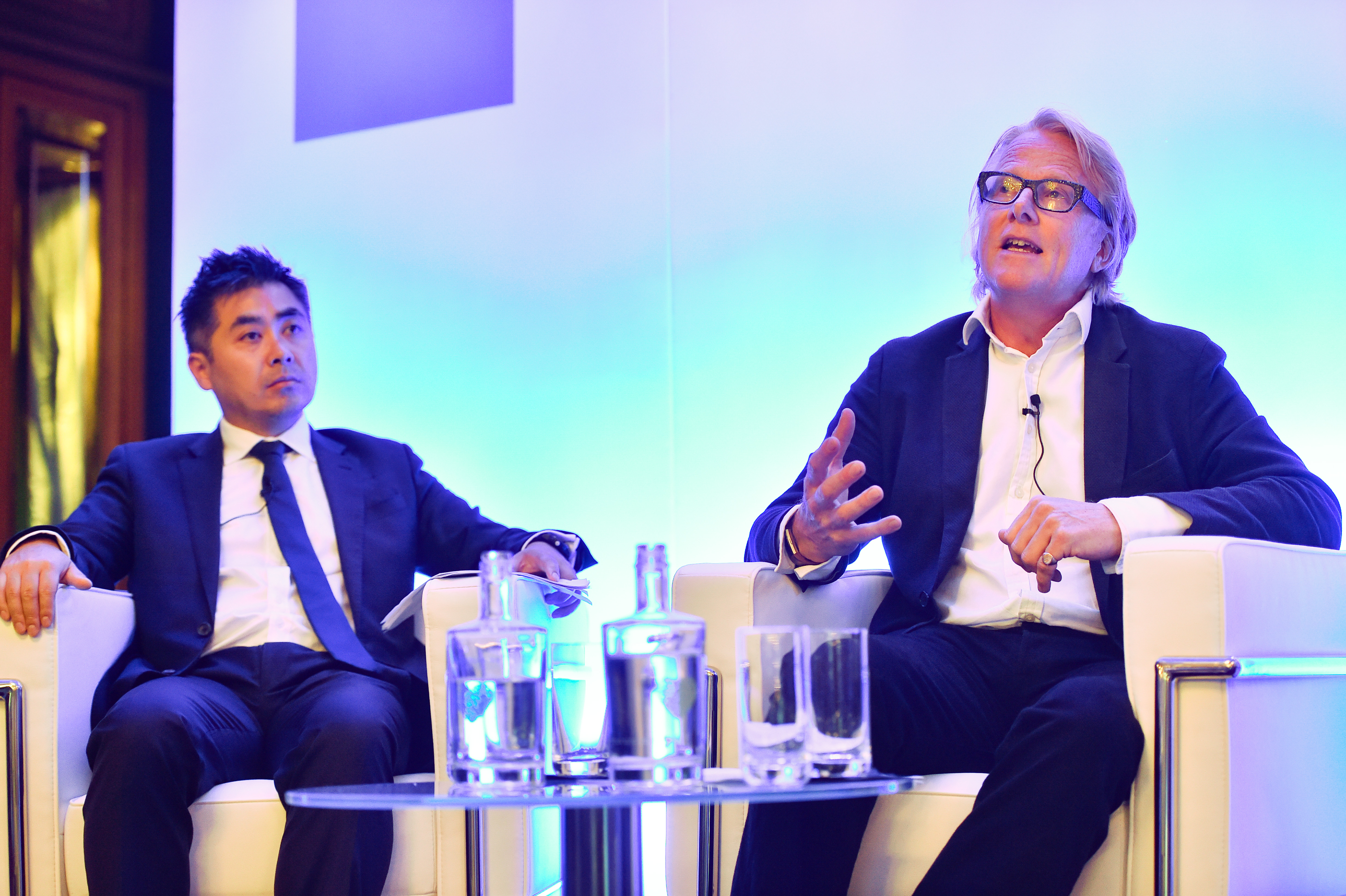 Niall Barton and Johnny Vo on stage at the Goldman Sachs European Financials Conference in Frankfurt