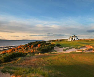 Photo of the golf course and club house at Royal Dornoch Golf Club