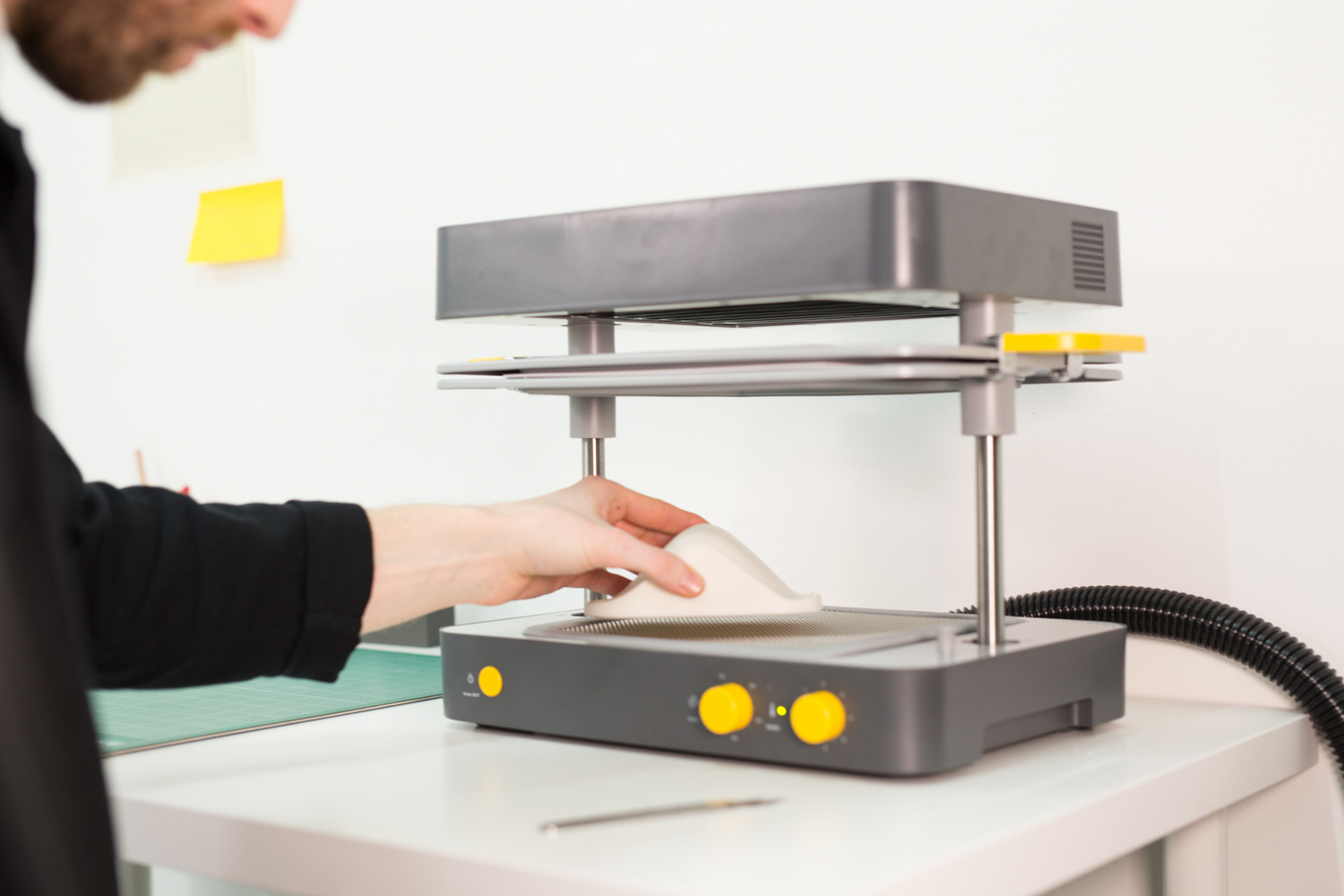 Industrial designer prototyping furniture with a 3D printer and a vacuum former
