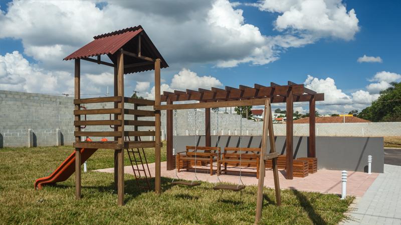 Área comum de lazer com playground do Residencial Acqua Park 2 em Araucária