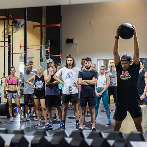 Man lifting weight ball