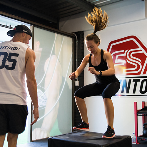 Fitstop trainer helping client