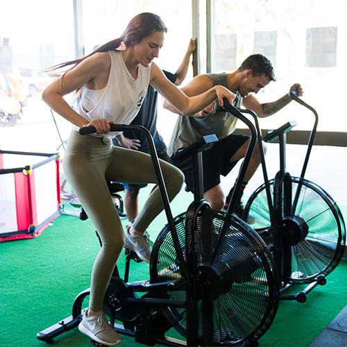 2 people on gym bikes