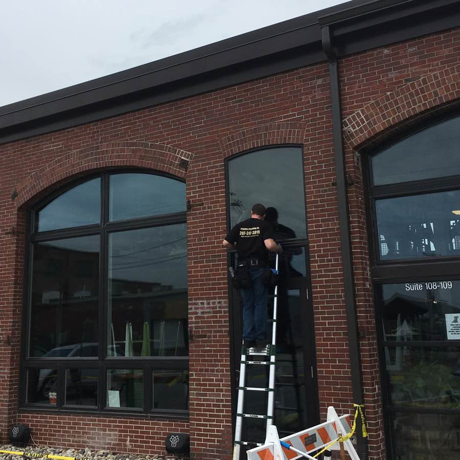 Commercial Windows Being Cleaned By Window Cleaning Crew In Portland Me